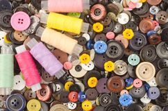 Buttons and bobbins of thread Stock Image