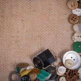 Buttons on burlap Royalty Free Stock Images