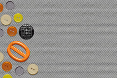 Buttons on canvas. Buttons on a seamless duck canvas texture forming some copy space on the right Stock Images