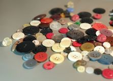 Buttons on clothes close-up. Multicolored buttons. Plastic buttons royalty free stock image
