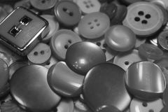 Buttons. Collection of loose metal and plastic buttons of various sizes and designs Stock Images