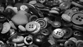 Buttons. Collection of loose metal and plastic buttons of various sizes and designs Stock Image