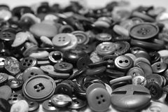 Buttons. Collection of loose metal and plastic buttons of various sizes and designs Stock Photos