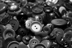 Buttons. Collection of loose metal and plastic buttons of various sizes and designs Stock Photo