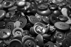 Buttons. Collection of loose metal and plastic buttons of various sizes and designs Stock Photography