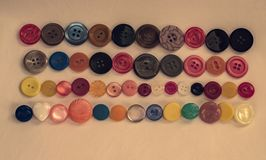 Buttons colored. Plastic and different sizes for clothes Royalty Free Stock Image