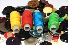 Buttons and colored threads. For sewing Royalty Free Stock Photography