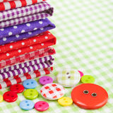 Buttons, colorful fabrics and buttons Royalty Free Stock Images