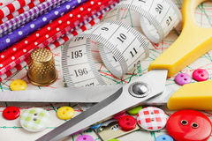 Buttons, colorful fabrics, scissors, measuring tape Stock Photo