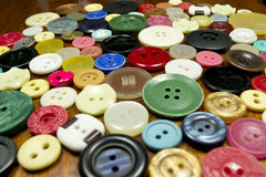 Buttons. Colorful plastic buttons on brown background Stock Images