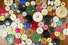 Buttons. Colorful plastic buttons on brown background Royalty Free Stock Photography