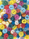 Buttons in confusion. Macro photo of colored buttons in confusion Stock Photos