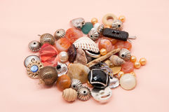 Buttons and costume jewellery. Set of buttons with costume jewellery Royalty Free Stock Images