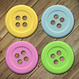 Buttons. Design in 3d of some buttons of different colors on a wood background Stock Photography