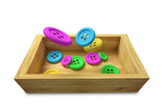 Buttons design in 3d. Design in 3d of some sewing buttons falling on a wooden box Stock Photo