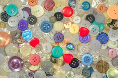 Buttons of different colors and designs, filling the entire frame stock photo