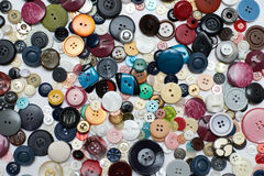 Buttons. Of different colors top view background Royalty Free Stock Photos