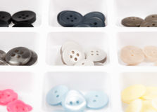 Buttons of different size, shape and color  on white Stock Photos