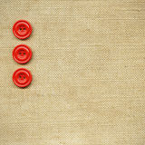 Buttons on fabric Stock Image