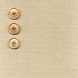 Buttons on fabric Stock Images