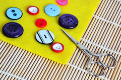 Buttons,felt and scissors Stock Photos