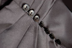 Buttons and folds on skirt Royalty Free Stock Images