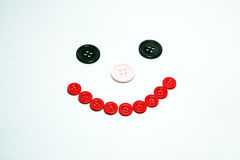 Buttons forming a smiling face. Stock Photo