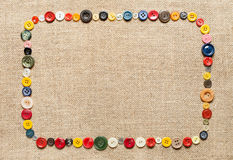 Buttons frame on texture background Stock Images