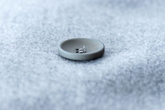 buttons on the gray coat Stock Images