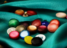 Buttons on the green cloth Royalty Free Stock Photography