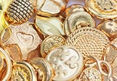 buttons guld Arkivbild