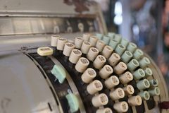 Vintage cash register. The buttons and handles on an old cash register royalty free stock photo