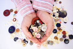 Buttons in the hands Stock Images