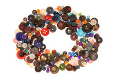 Buttons. Heap of plastic colorful buttons, round creative framework is on white Stock Image