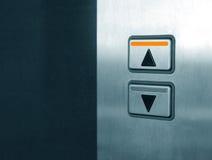 buttons hissen Arkivfoto