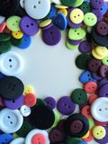 Buttons II. Colorful buttons nestled together with white space in middle Stock Photography