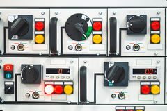 The buttons on the industrial equipments. Control buttons on industrial equipments royalty free stock photo