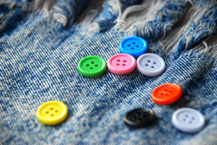 Buttons on jeans background Royalty Free Stock Images