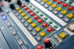 Buttons and knobs on audio mixer stock photography