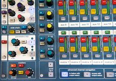 Buttons and knobs on stereo audio mixer Royalty Free Stock Photo