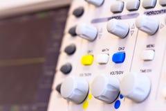 Buttons of laboratory digital oscilloscope. Adjustable buttons and knobs of laboratory digital oscilloscope Stock Photo