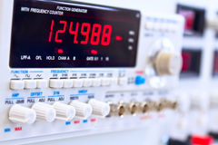 Buttons of laboratory function generator. Buttons and knobs of laboratory function generator with frequency counter Royalty Free Stock Image