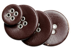 Buttons leather on a white background Royalty Free Stock Photos