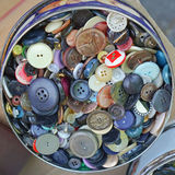 Buttons. Lots of sewing buttons in the box Stock Images