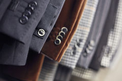 Buttons on luxurious jackets' sleeves. Detail of men's jackets' line in a shop, DOF Royalty Free Stock Photo