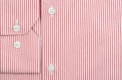 Buttons on man's striped red shirt Stock Photos