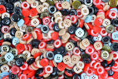 Buttons of many colors. Closeup of a pile of buttons of many colors Stock Photo