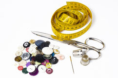 Buttons, meter, scissors, thimble and needle Royalty Free Stock Image