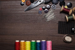 Buttons, needles and multicolored threads Royalty Free Stock Photography