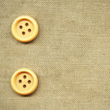 Buttons on old cloth Stock Images